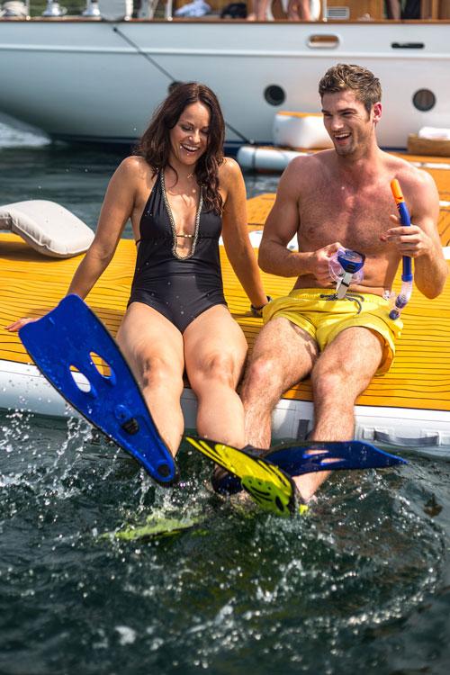 Couple sat at waters edge on inflatable platform - Nautibuoy Marine