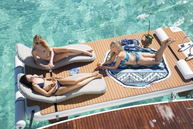 Friends relaxing on inflatable platforms with chairs and headrests - Nautibuoy Marine