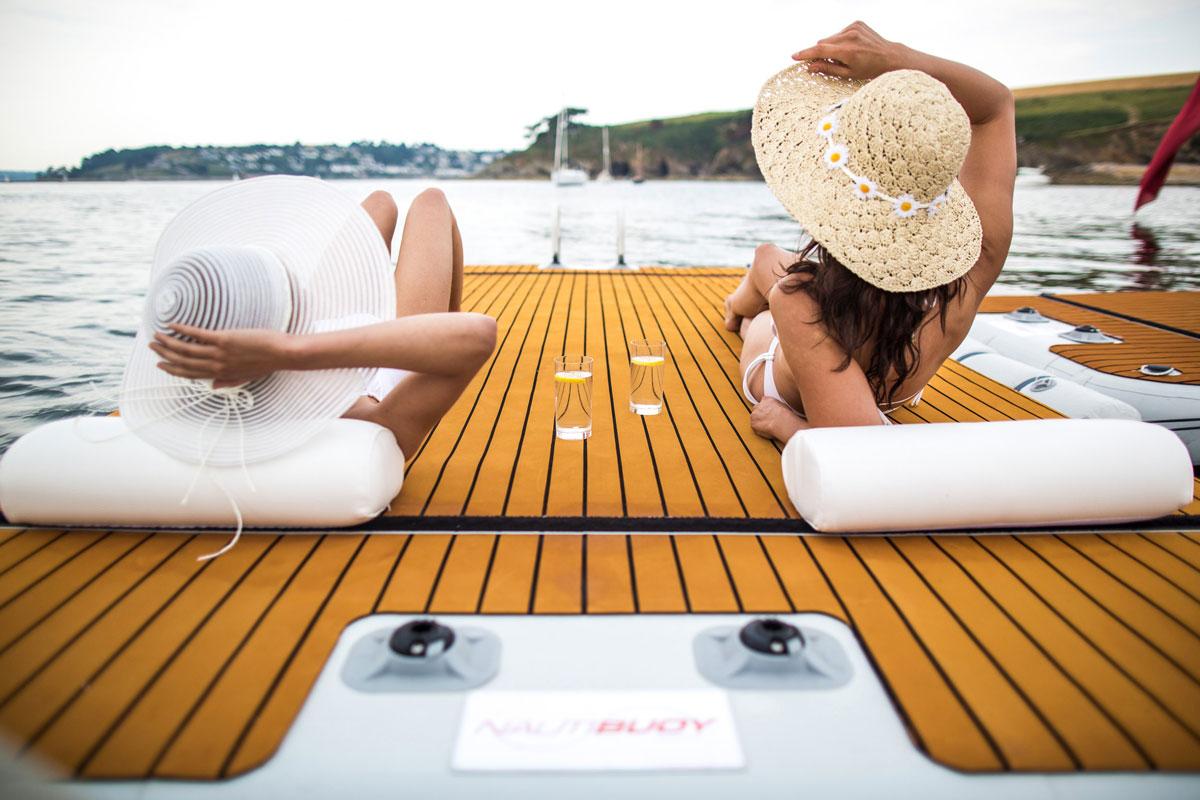Inflatable platform with people sunbathing and using headrests - Nautibuoy Marine