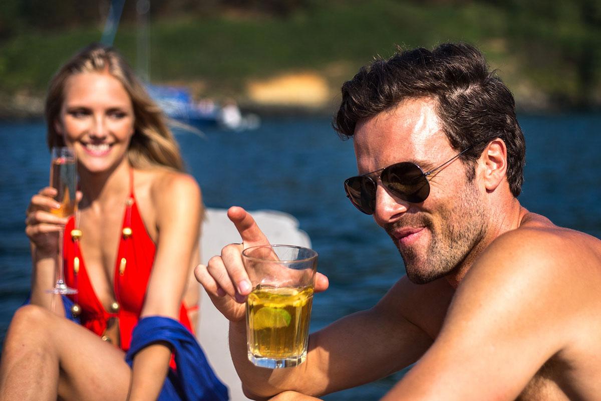 Couple drinking on inflatable platform - Nautibuoy Marine