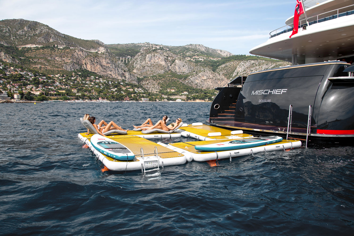 People relaxing on inflatable platforms in a square configuration - Nautibuoy Marine