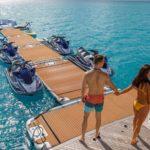 Couple viewing long inflatable pontoon - Nautibuoy Marine