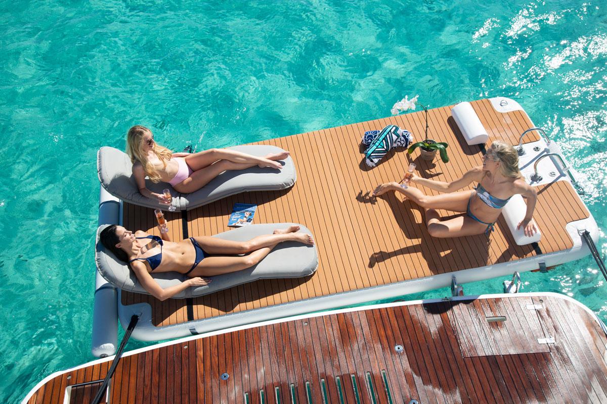 Nautibuoy inflatable platform with women using headrest attachment - Nautibuoy Marine
