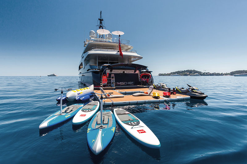 Yacht with square inflatable platform configuration for watersport equipment - Nautibuoy Marine