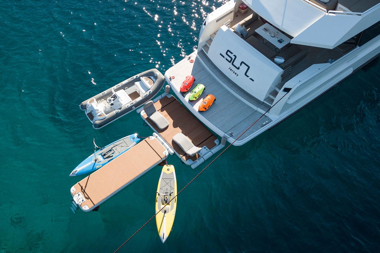 Yacht with t-shape inflatable platform configuration as a watersports dock - Nautibuoy Marine